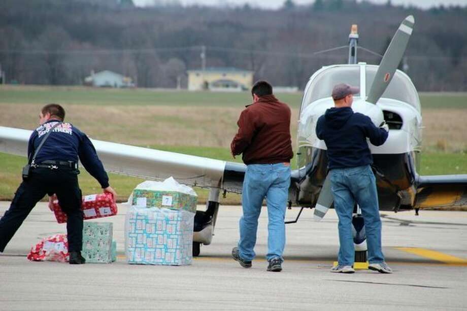 This 2016 photo shows Operation Good Cheer volunteers at Roben-Hood Airport in Big Rapids. Operation Good Cheer is set to return to the area on Dec. 7. (Courtesy photo)