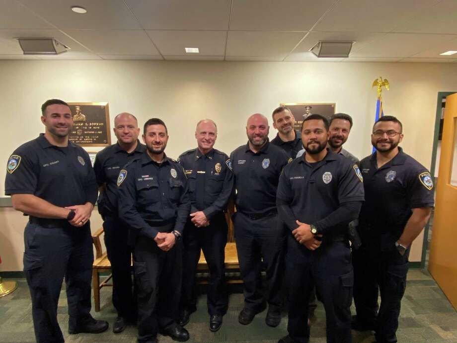 From left, Officers Cusano, Moura, Jimenez, Chief Donald Anderson, Officers Ehret, Clohessy, Fiscella, Sgt. Skoumbros, and Officer Vigil Photo: Darien Police /