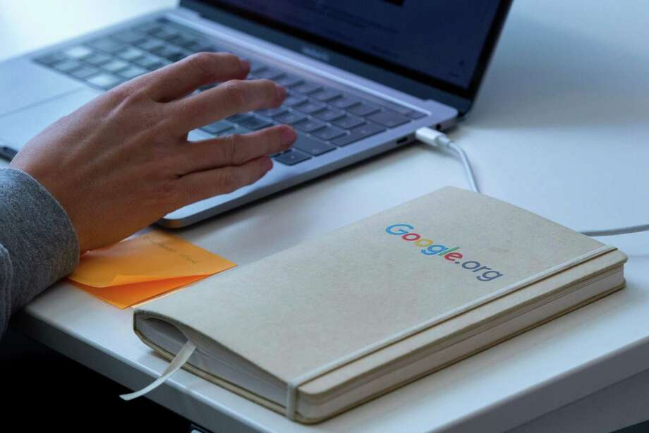 A Google.org logo sits on a notebook inside Google LLC's office in Berlin, Germany, on Wednesday, May 29, 2019. Google Chief Executive Officer Sundar Pichai turned down a big new grant of restricted stock in 2018 because he felt he was already paid generously, according to a person familiar with the decision. Photographer: Krisztian Bocsi/Bloomberg Photo: Krisztian Bocsi, Bloomberg / © 2019 Bloomberg Finance LP