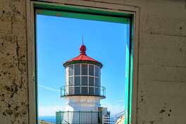 This is an interesting perspective of the lighthouse at Point Reyes National Seashore. Looking through the doorway of an adjacent building.