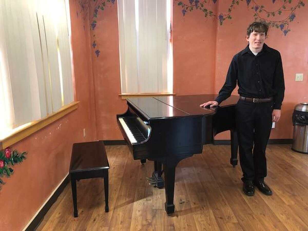 Thomas Ice of New Haven with baby grand piano.