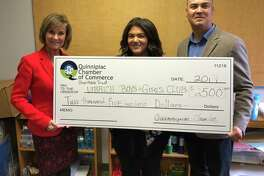 """SUPPORTING STEM: From left, Quinnipiac Chamber of Commerce Executive Director Dee Prior Nesti, Ulbrich Boys & Girls Club North Haven Unit Director Alexandra James and UBGC Executive Director Carlos Collazo with a check from the Quinnipiac Chamber of Commerce Charitable Trust supporting STEM learning at the club. """"The Quinnipiac Chamber of Commerce STEM Learning Center at our North Haven Unit will inspire our youth, showcase career opportunities, and prepare them to address real-world problems. Without the support of community partners such as the Quinnipiac Chamber of Commerce, we would not be able to provide our high level of programs while keeping the Club affordable for families,"""" Collazo said in a release."""