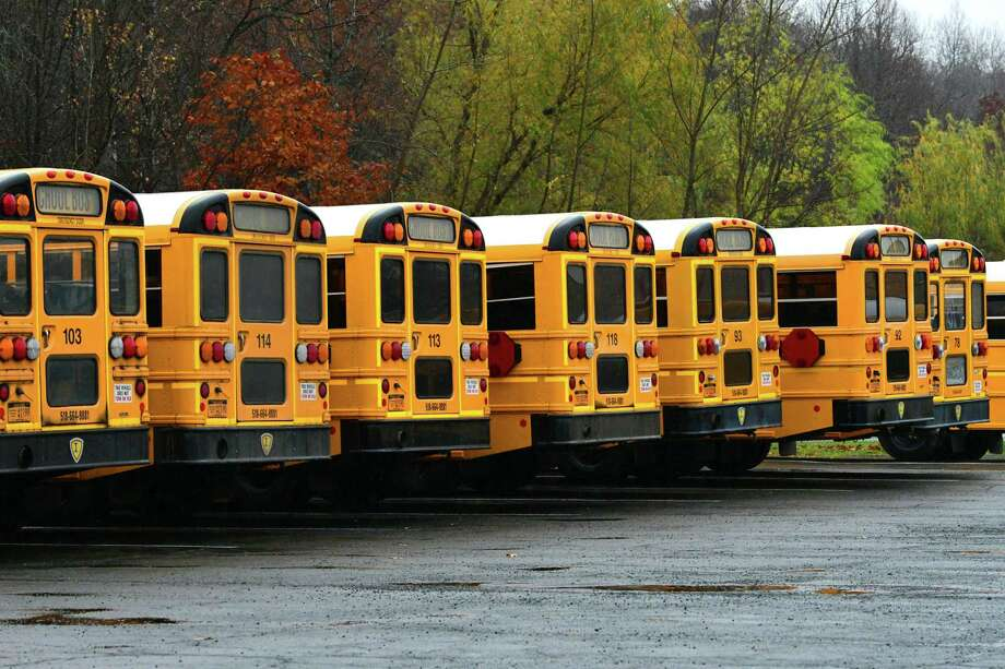Mechanicville school buses are seen at the school bus garage in front of Mechanicville High School on Thursday, Nov. 7, 2019 in Mechanicville, N.Y. The district made a decision to end busing for district students who attend private and parochial school (Lori Van Buren/Times Union) Photo: Lori Van Buren, Albany Times Union / 40048221A