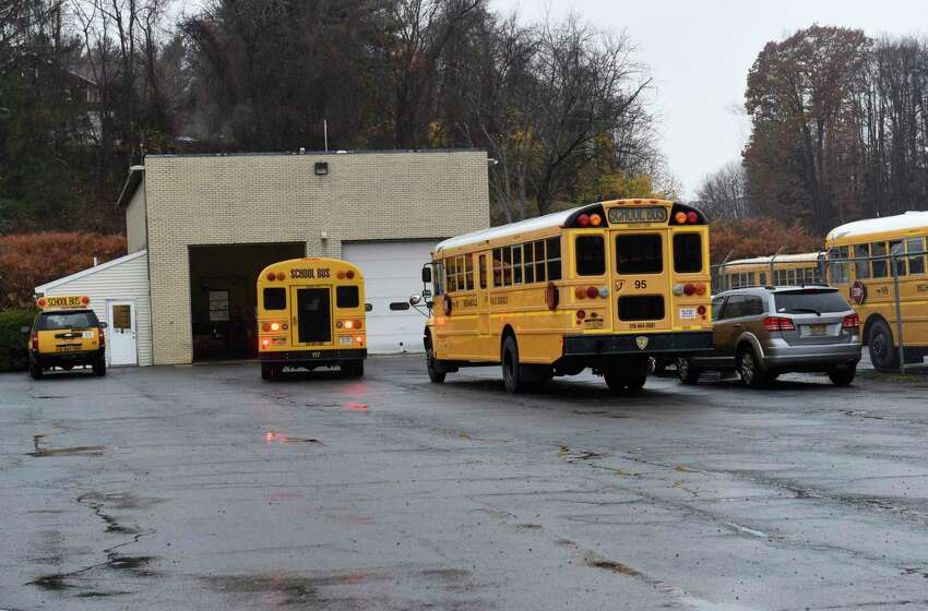 A Mechanicville school bus is seen entering the school bus garage in front of Mechanicville High School on Thursday, Nov. 7, 2019 in Mechanicville, N.Y. The district made a decision to end busing for district students who attend private and parochial school (Lori Van Buren/Times Union)
