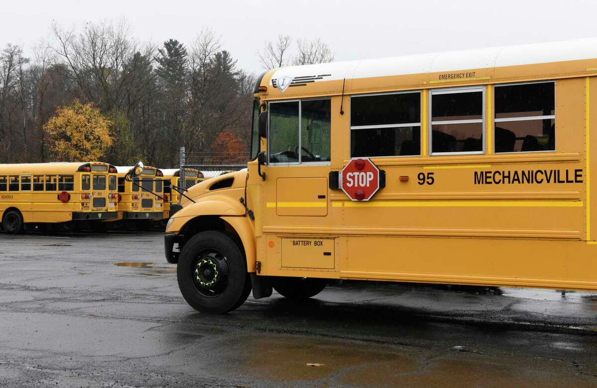 Mechanicville school buses are seen at the school bus garage in front of Mechanicville High School on Thursday, Nov. 7, 2019 in Mechanicville, N.Y. A high schooler tested positive for coronavirus after a 'super-spreader' community event, the district said on Nov. 19, 2020. (Lori Van Buren/Times Union)