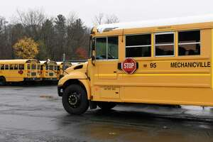 Mechanicville school buses are seen at the school bus garage in front of Mechanicville High School on Thursday, Nov. 7, 2019 in Mechanicville, N.Y. The district made a decision to end busing for district students who attend private and parochial school (Lori Van Buren/Times Union)