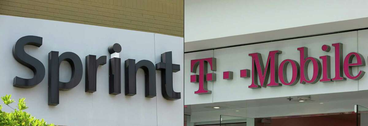 (COMBO) This combination of pictures created on November 5, 2019 shows The Sprint logo seen outside a shop in Washington, DC, on July 26, 2019. and The T-Mobile logo is seen outside a shop in Washington, DC, on July 26, 2019. - The US telecom regulator on November 5, 2019 approved the merger of T-Mobile and Sprint, moving the tie-up of the third- and fourth-largest US carriers closer to completion. The Federal Communications Commission cleared the $26 billion deal three months after approval by US Justice Department antitrust officials. (Photos by Alastair Pike / AFP) (Photo by ALASTAIR PIKE/AFP via Getty Images)