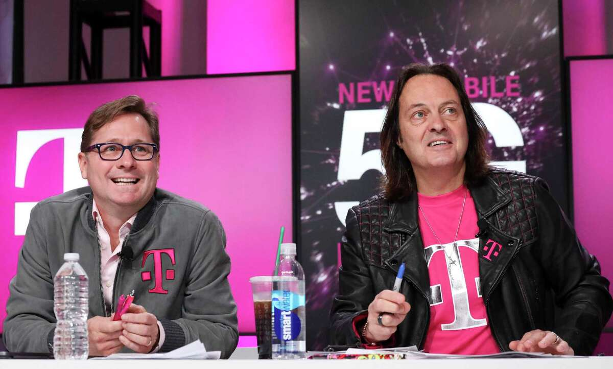 T-Mobile President Mike Sievert and CEO John Legere answer caller questions during the announcement of the future New T-Mobile's Un-carrier Moves on Thursday, Nov. 7, 2019, in New York.