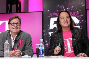 IMAGE DISTRIBUTED FOR T-MOBILE - Un-carrier President Mike Sievert and CEO John Legere answer caller questions during the announcement of the future New T-Mobile's Un-carrier Moves on Thursday, Nov. 7, 2019, in New York. The Un-carrier unveiled three new initiatives for the proposed combination of T-Mobile and Sprint including the Connecting Heroes Initiative, a 10-year commitment to providing free unlimited talk, text and smartphone data for public and non-profit U.S. state and local law enforcement, fire and EMS agencies. (Brian Ach/AP Images for T-Mobile)