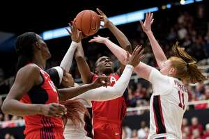 USA forward Nneka Ogwumike (16) shoots as Stanford forward Ashten Prechtel, right, and Stanford guard Kiana Williams, left, defend in the second quarter of an exhibition women's basketball game, Saturday, Nov. 2, 2019, in Stanford, Calif. (AP Photo/John Hefti)