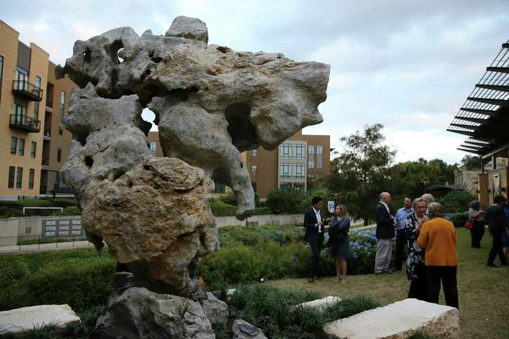 "The San Antonio Museum of Art unveils the Taihu rock last week. ""It just sits above the river,"" Katie Luber of SAMA says. ""It's all about contemplation. … You see this great, giant thing, and it's like the spirit of the river. It's so beautiful and comforting."""