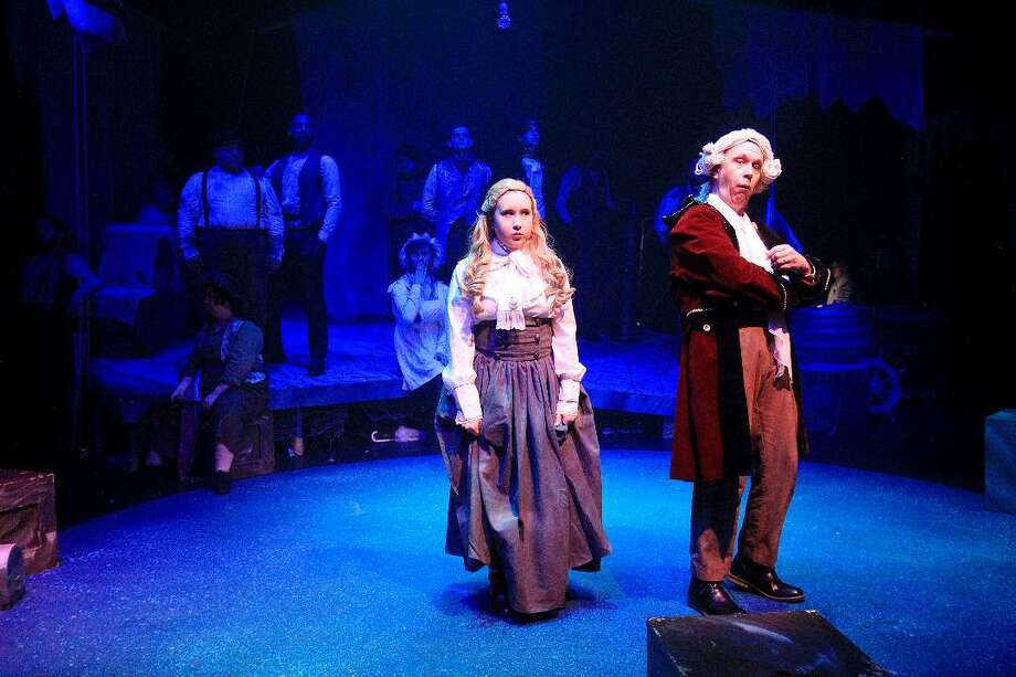 "Molly, portrayed by Anna Grygier, and Lord Leonard Aster, played by Michael Grygier, discuss the importance of their secret mission for Queen Victoria in the COM Theatre production of ""Peter and the Starcatcher."""