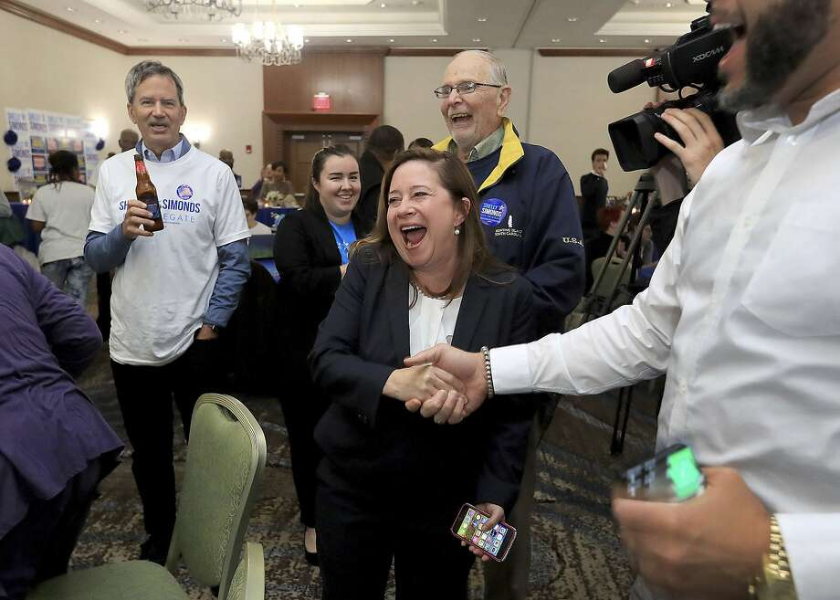 Shelly Simonds celebrates with supporters in Newport News after winning a seat in the Virginia House of Delegates. Photo: Rob Ostermaier / Associated Press
