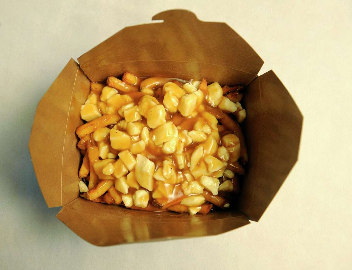 FILE-- After five years in Berkeley, Smoke's Poutinerie closes their last California location. Pictured is their traditional poutine.