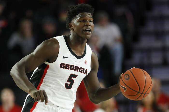 FILE - In this Friday, Oct. 18, 2019, file photo, Georgia's Anthony Edwards (5) dribbles the ball up during an NCAA college basketball exhibition game against Valdosta State in Athens, Ga. Tom Crean wasted little time in landing arguably the highest-rated recruit in school history, and all he had to do was head down to Atlanta to see Edwards play for Holy Spirit Prep. (Joshua L. Jones/Athens Banner-Herald via AP, File)