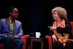 "Historian Ibram X. Kendi, author of ""How to Be an Antiracist,"" and activist Angela Davis take part in a discussion panel in San Francisco in January. The book is a great start for people who want to better themselves."