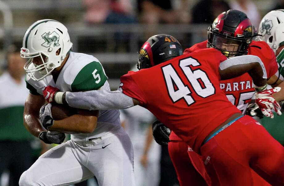 Porter linebacker Zhyon Bell (46) is the leader of the No. 1 defense in the district. The Spartans are allowing just 130 yards per game. Photo: Jason Fochtman, Houston Chronicle / Staff Photographer / Houston Chronicle