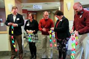 """To commemorate the opening of the new pediatric observation unit, staff members did a ceremonial """"ribbon cutting"""" with colored construction paper linked together to form a rope.Vice president of medical affairs for Spectrum Health Grand Rapids and the Children's hospital Matthew Denenberg said this rope was made by children from Helen DeVos Children's Hospital for the cutting.(Pioneer photo/Alicia Jaimes)"""