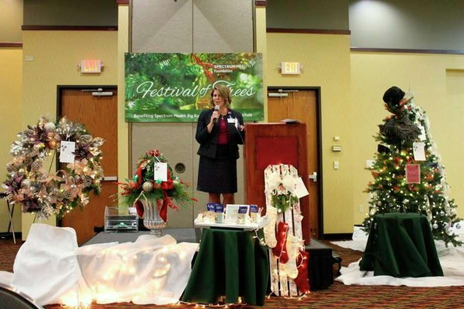 Spectrum Health Big Rapids and Reed City Hospitals President Andrea Leslie addresses the crowd. Leslie thanked attendees for coming and their continual support of the Festival of Trees event. (Courtesy photo)
