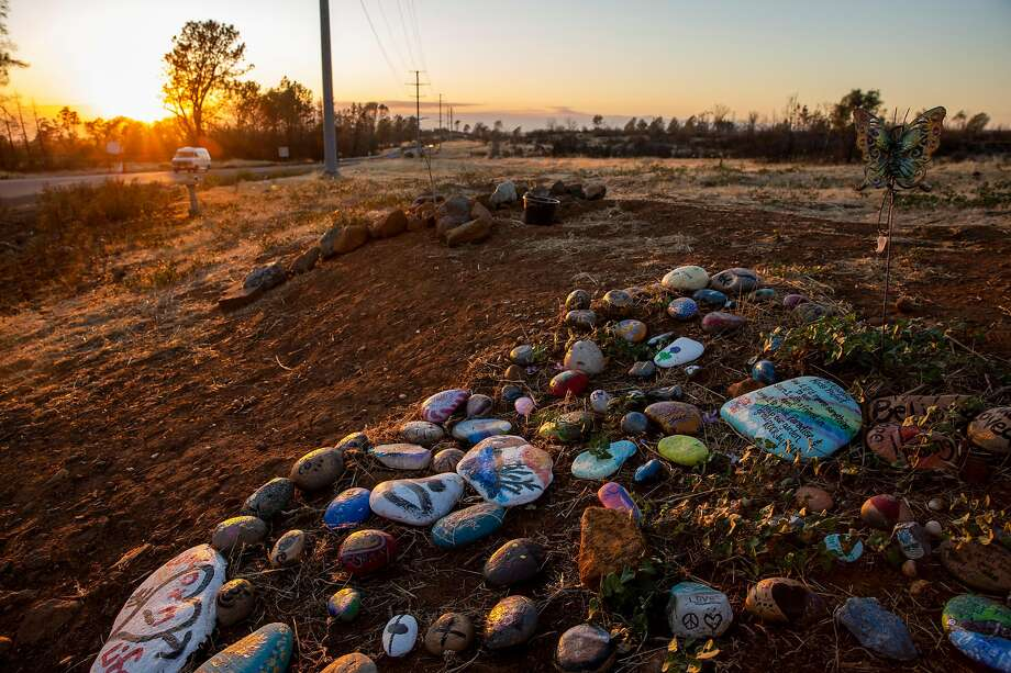 A makeshift memorial in Paradise commemorates the 85 people killed in the Camp Fire. Each victim but one has a name. Did he die trying to save Ellen Walker? Photo: Photos By Santiago Mejia / The Chronicle