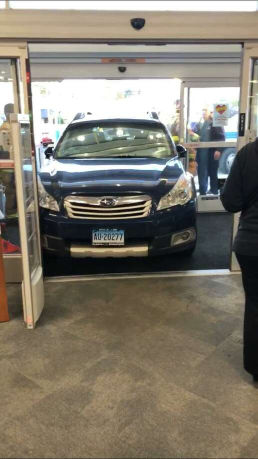 An older man crashed through the front doors of CVS on West Main Street in Stamford on Wednesday afternoon. No injuries were reported. Photo: Emilio Inzhin / Contributed Photo / Stamford Advocate contributed