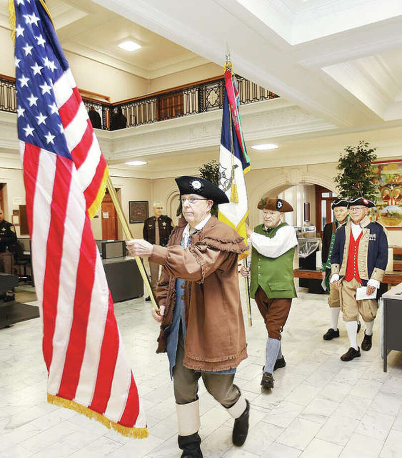 Members of the Gen. George Rogers Clark Chapter of the Illinois Society, Sons of the American Revolution, post the colors at the start of the 23rd Annual Flag Award Ceremony held Thursday in the lobby of the Madison County Courthouse in Edwardsville. Twelve households were honored Thursday for their flying of the American flag as the 2019 SAR Flag Award Recipents.