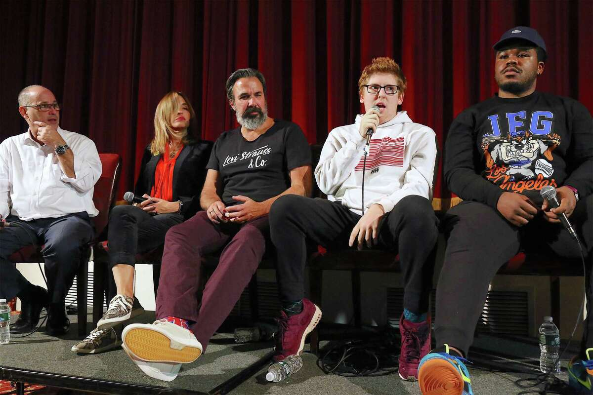 """The panelists include, from left, Fred Guttenberg, Patricia and Manuel Oliver, all three of whom lost children to gun violence in Parkland, Fla., and Matt Deitsch and Jammal Lemy, two students survivors of the shooting, at the public premiere of the documentary """"Parkland Rising"""" at The Avon Theatre on Wednesday, Nov. 6, 2019, in Stamford, Conn. Below,"""