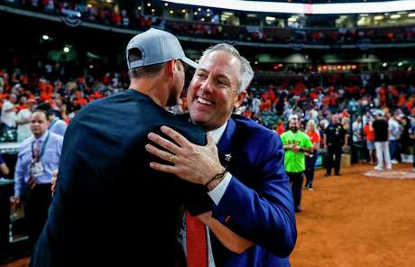 Reid Ryan, celebrating the team's Game 5 win the ALDS, will move from team president to executie advisor, business relations as part of a reorganization.