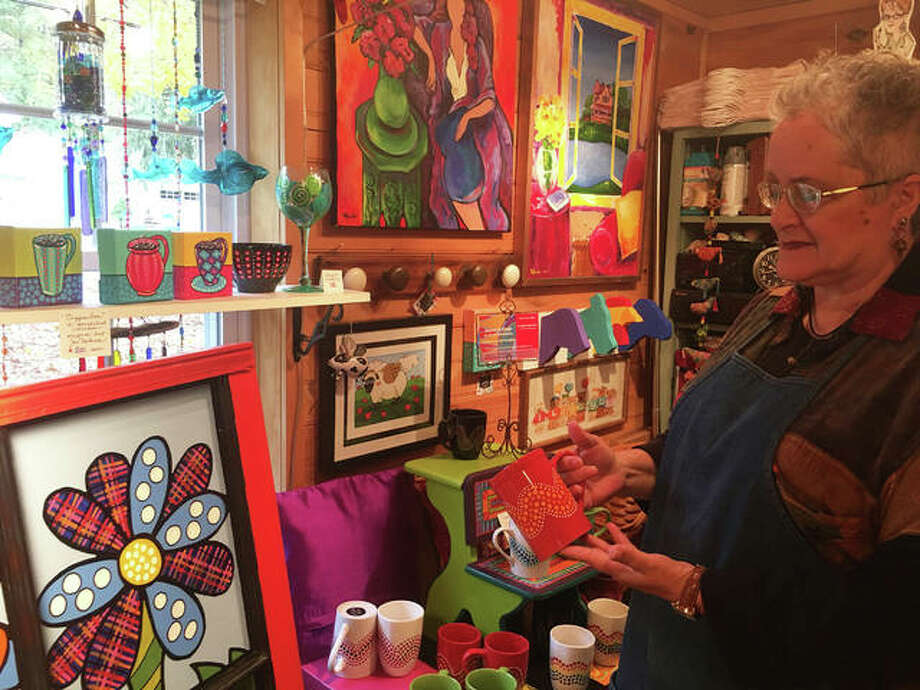 Artist Wendy DeBrock shows some of her artwork at her studio, Sisters of Elsah Art Studio and Gallery, 108 Mill St., which is open to the public Saturdays and Sundays. DeBrock's artwork for sale includes hand-painted stemwear, wine glasses, Cuppa Joe mugs, Elsah-inspired coffee mugs and textile designs. Photo: (Jill Moon|The Edge)