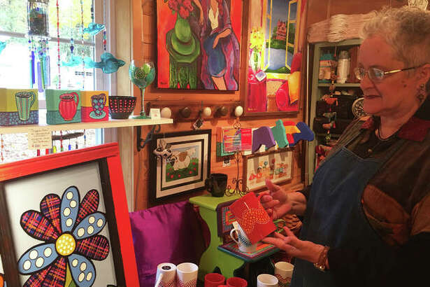 Artist Wendy DeBrock shows some of her artwork at her studio, Sisters of Elsah Art Studio and Gallery, 108 Mill St., which is open to the public Saturdays and Sundays. DeBrock's artwork for sale includes hand-painted stemwear, wine glasses, Cuppa Joe mugs, Elsah-inspired coffee mugs and textile designs.