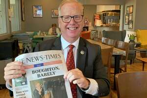 Mayor Mark Boughton shows the local newspaper the day after winning an unprecedented 10th term.