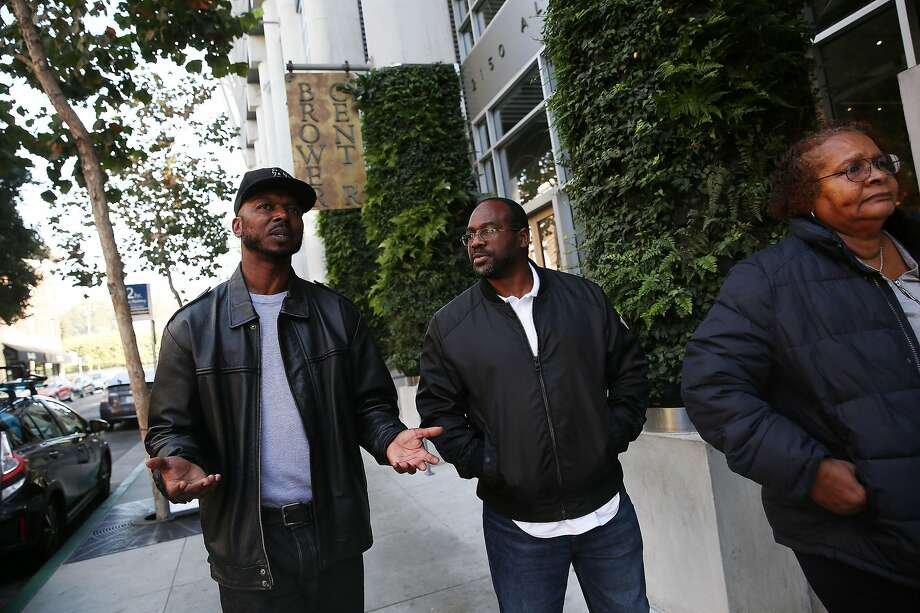 Formerly incarcerated John Jones III (left), formerly incarcerated Lee Bonner, and Anita Wills, whose son is incarcerated walk, on Allston Way in Berkeley. Photo: Lea Suzuki / The Chronicle