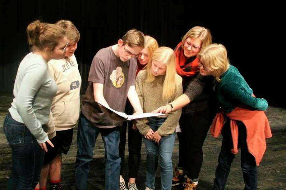 """Members of the cast of the Manistee Middle/High School drama program go over the script to the play""""Vanderpool and Field Resuscitated"""" that was written by Manistee County Historical Museum executive director Mark Fedder about a famous murder that occurred in Manistee in 1869. The students will be performing that play and """"Disaster"""" by Don Zoldis at 7 p.m. on Nov. 15 and 16 and again at 2 p.m. on Nov. 17. (Ken Grabowski/News Advocate)"""