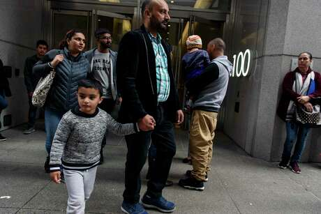 People walk in and out of San Francisco Immigration Court. The nation's immigration courts are not a part of the independent judiciary, but fall under the Department of Justice, leaving them open to interference by political appointees.