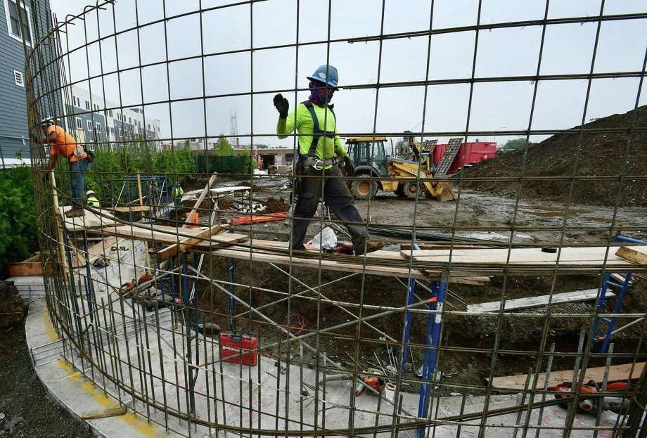 Construction workers on the job in June 2019 in Norwalk, Conn. Connecticut had among the lowest economic growth rates in the second quarter, according a Nov. 7 study by the Bureau of Economic Analysis. Photo: Erik Trautmann / Hearst Connecticut Media / Norwalk Hour