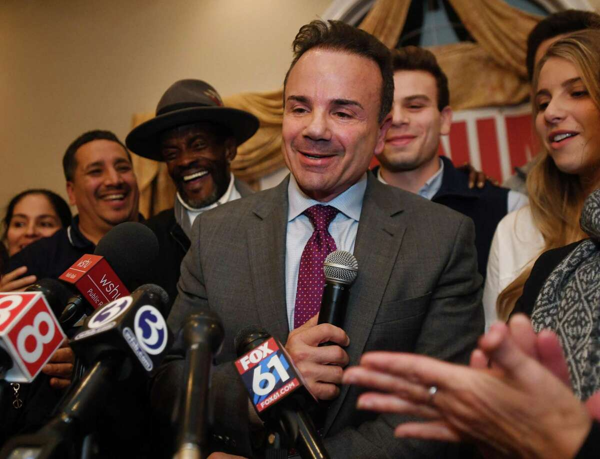 Surrounded by family and supporters, Bridgeport Mayor Joe Ganim smiles as he delivers his re-election victory speech at Testo's Restaurant in Bridgeport, Conn. on Tuesday, November 5, 2019.