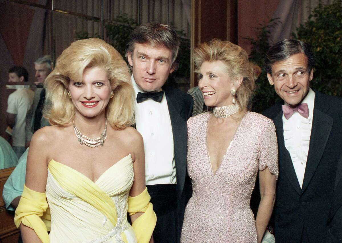 Ivana and Donald Trump enter a tribute gala to honor Nellie Connally at the Westin Galleria ballroom with their Houston hostess, Joan Schnitzer, and Continental Airlines' Frank Lorenzo. The gala, A Night for Nellie, benefited the Juvenile Diabetes Foundation.