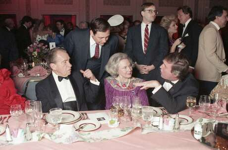 Former President Richard Nixon, from left, Nellie Connally and Donald Trump visit at a tribute gala to Connally at the Westin Galleria.