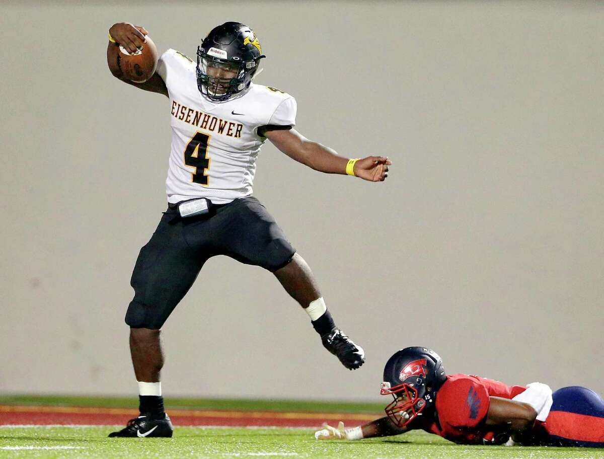 Eisenhower's Sevan Guidry (4) slips the tackle attempt by Aldine Davis' Reggie to score on a 51 yard run during the fourth quarter of their game at Thorne Stadium Friday, Oct. 26, 2018 in Houston, TX.