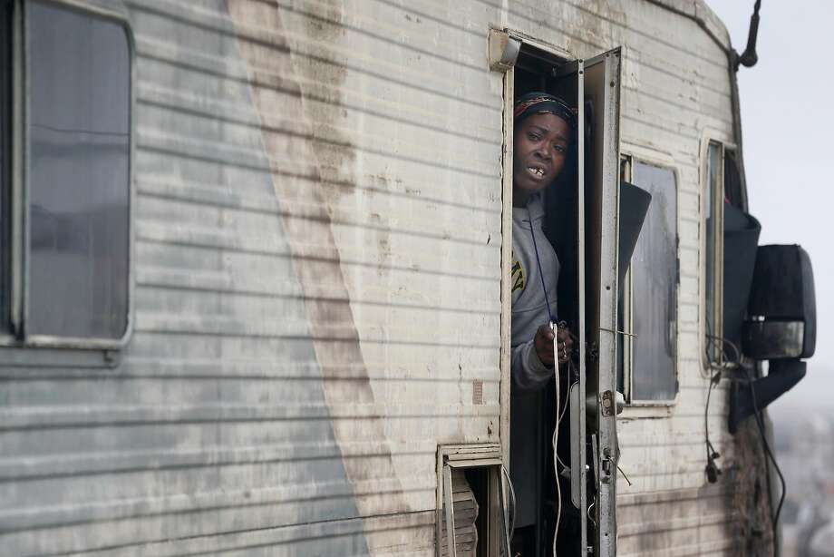 Ieshia Moss prepares to move out of a homeless encampment on Wood Street in Oakland, where she's lived for five years. Photo: Paul Chinn / The Chronicle