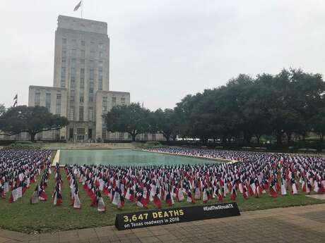 Outside Houston City Hall, transportation officials staked 3,647 Texas flags, one for each of the people killed on state roadways in 2018, for an event Nov. 7, 2019, marking the 19th anniversary of the last day without a road fatality in Texas.