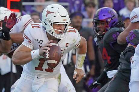 Texas quarterback Sam Ehlinger (11) is pictured in the second half of an NCAA college football game against TCU in Fort Worth, Texas, Saturday, Oct. 26, 2019. (AP Photo/Louis DeLuca)
