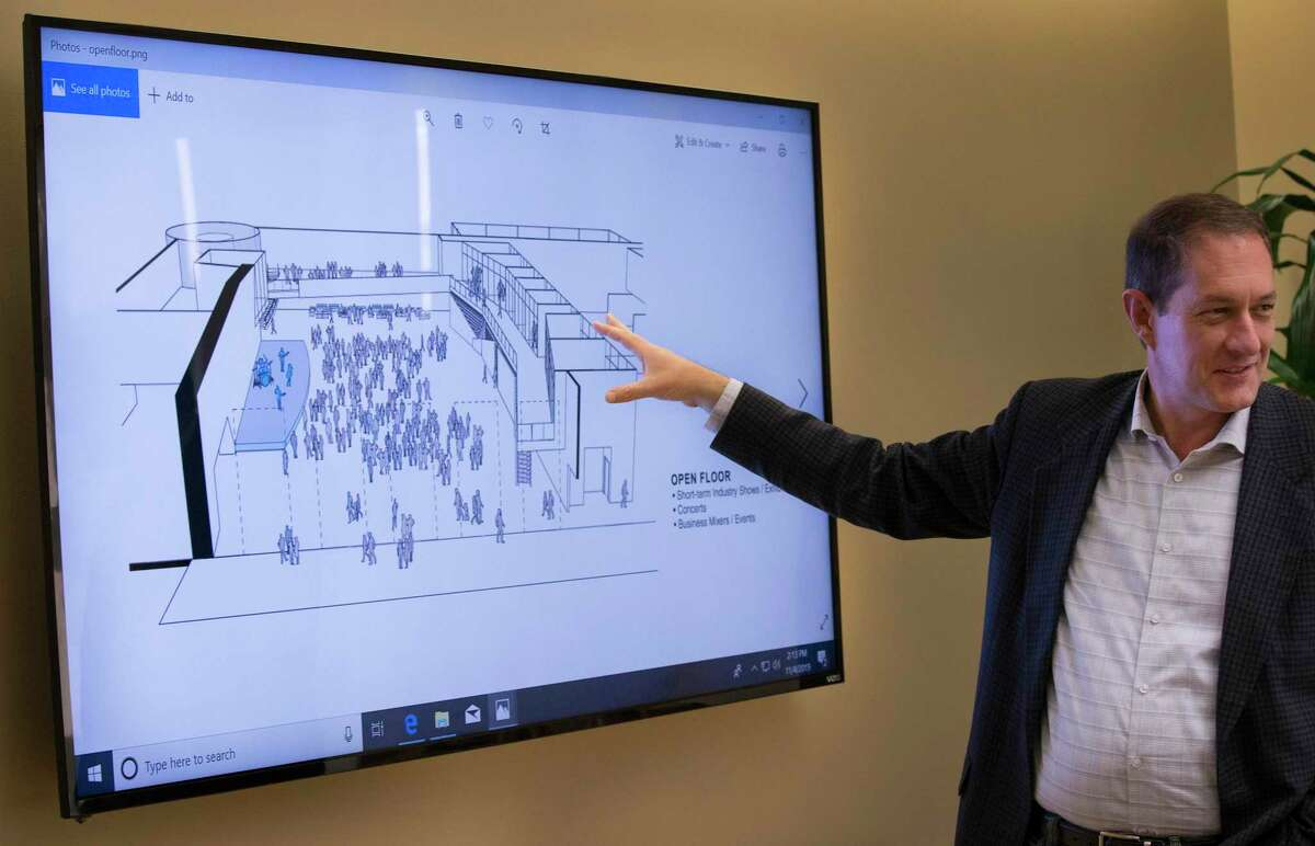 Jim Perschbach, Port San Antonio CEO, shows an illustration for an open floor of an upcoming innovation center in San Antonio in this November 2019 photo.