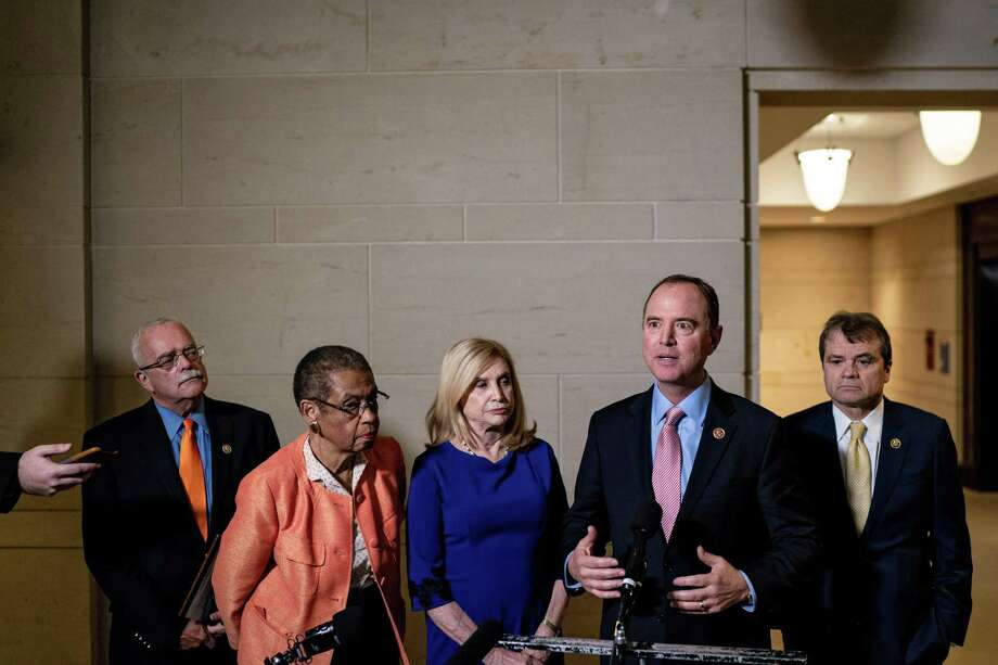From left, Rep. Gerry Connolly (D-Va.), Del. Eleanor Holmes Norton (D-D.C.), Rep. Carolyn Maloney (D-N.Y.), Rep. Adam Schiff (D-Calif.), the chairman of the House Intelligence Committee, and Rep. Mike Quigley (D-Ill.), talk with reporters at the Capitol in Washington on Wednesday, Nov. 6, 2019. The House Intelligence Committee will hold the first public hearings in the impeachment inquiry next week. (Erin Schaff/The New York Times) Photo: ERIN SCHAFF, STF / NYT / NYTNS
