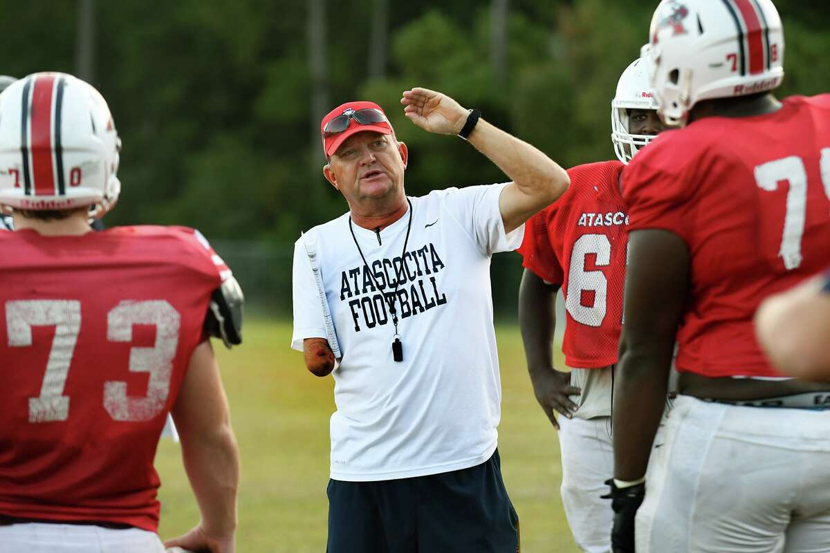 Atascocita offensive line coach Todd Moses, center, leads his squad, including junior Zander Tompkins, left, and Jer'Marques Bailey, right, during practice at AHS on Nov. 5, 2019.
