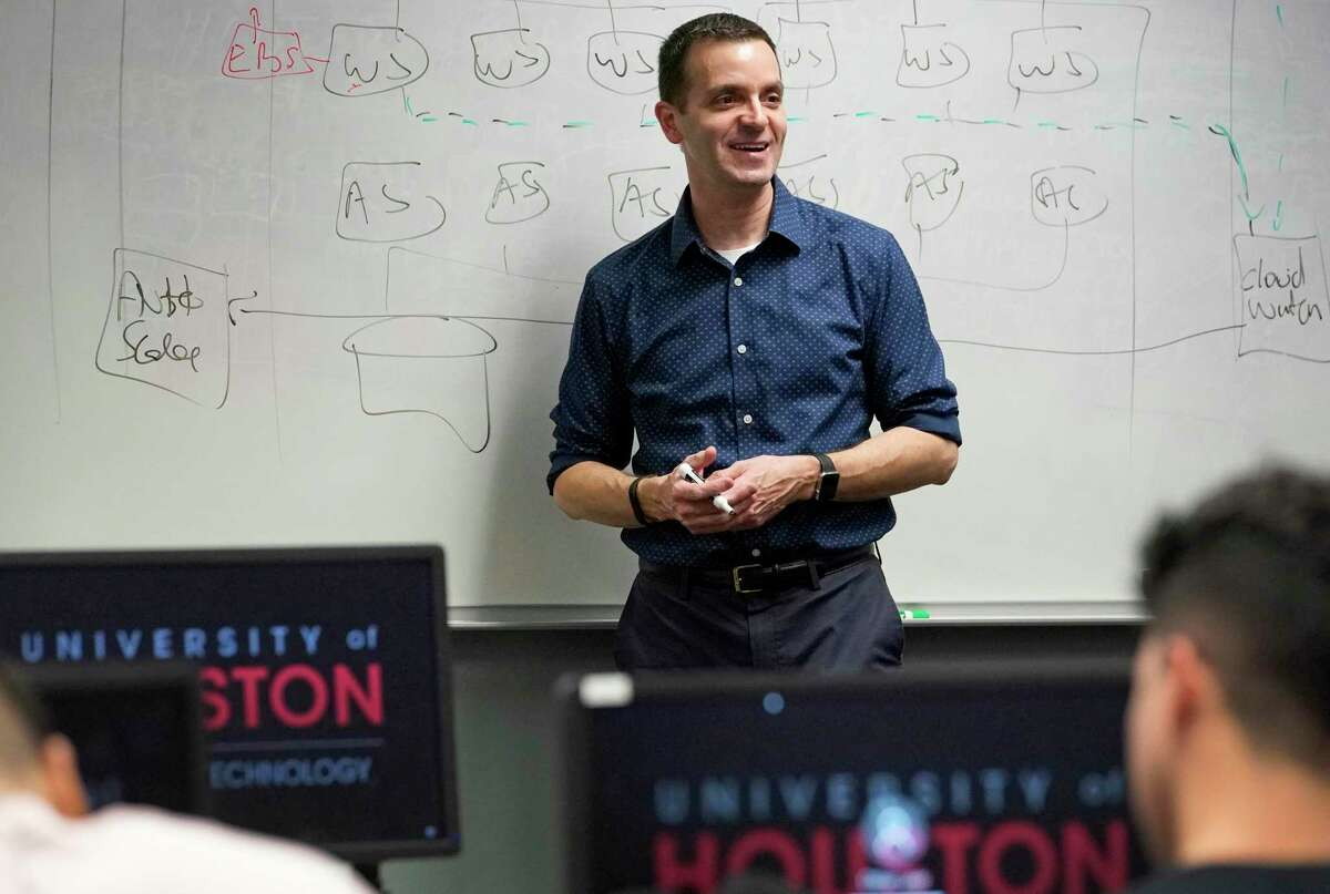 José C. Martínez, an instructional assistant professor of computer information systems, is shown during his class on cloud computing at University of Houston Tuesday, Oct. 29, 2019, in Houston.