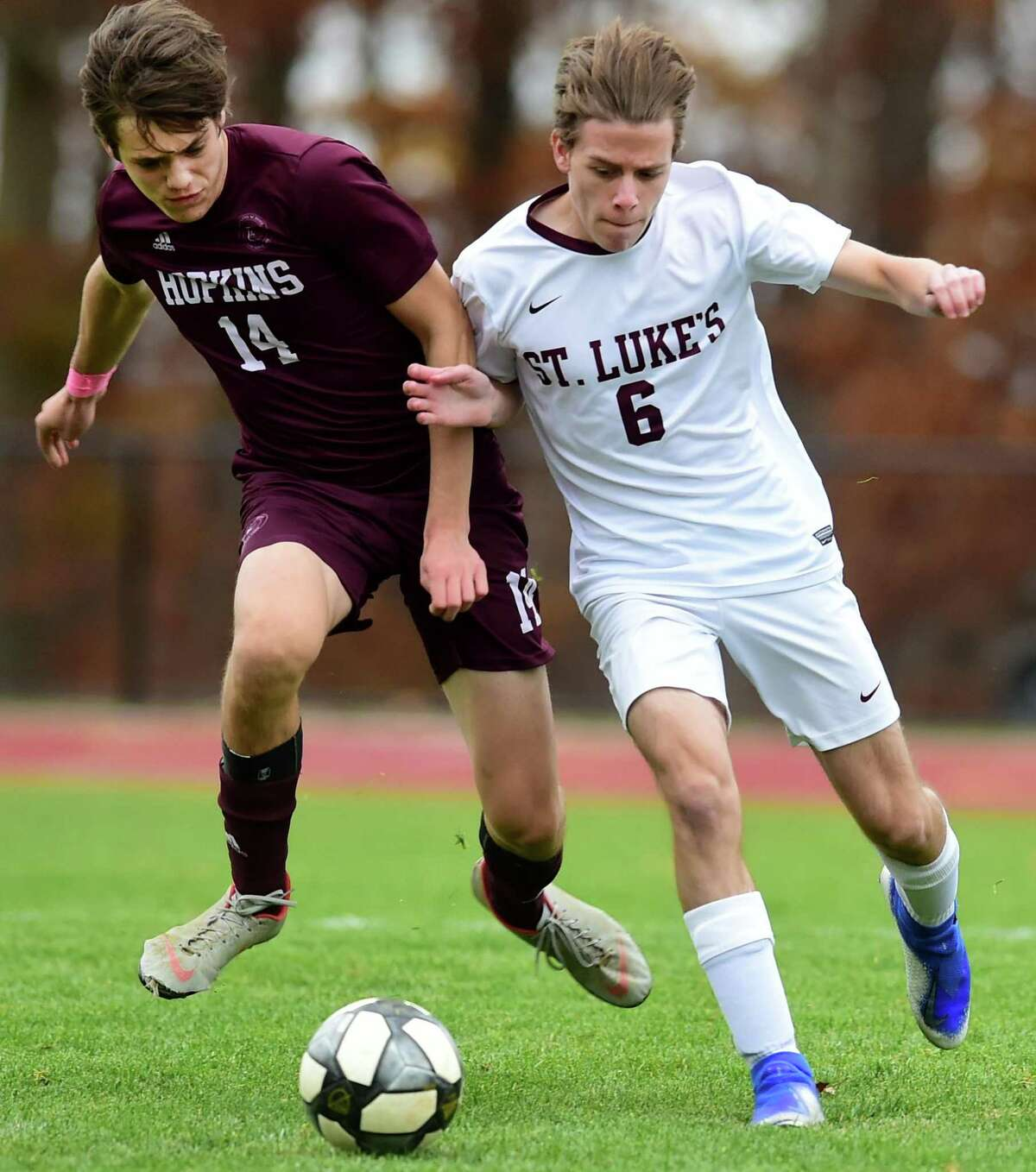 Hopkins' Zachary Bleil, left, and St. Luke's Pierce Leclerc chase the ball during the first half of the Fairchester Athletic Association Championship game Thursday in New Haven.