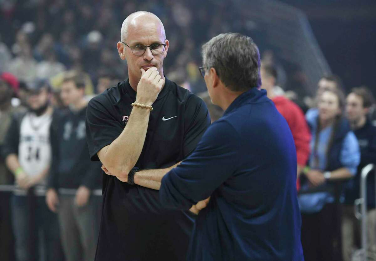 Connecticut men's head coach Dan Hurley, left, talks with women's head coach Geno Auriemma during UConn's men's and women's basketball teams annual First Night celebration in Storrs, Conn, Conn., Friday, Oct. 18, 2019, in Storrs, Conn. (AP Photo/Jessica Hill)