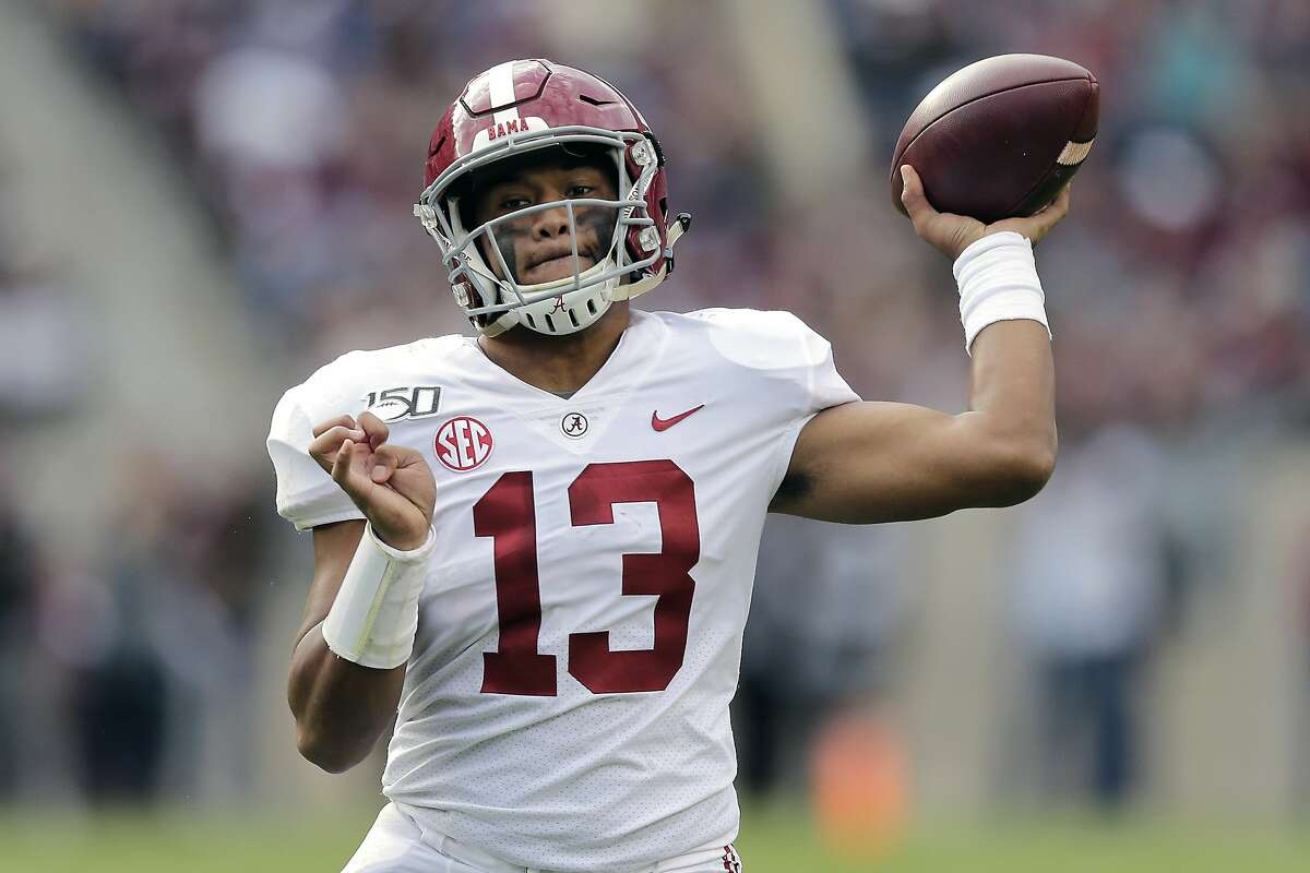 FILE - In this Oct. 12, 2019, file photo, Alabama quarterback Tua Tagovailoa passes against Texas A&M during the second half of an NCAA college football game in College Station, Texas. A high-stakes tilt between LSU and Alabama could prove as pivotal in Heisman Trophy voting as it is in providing the winner an inside track to the College Football Playoff. (AP Photo/Sam Craft, File)