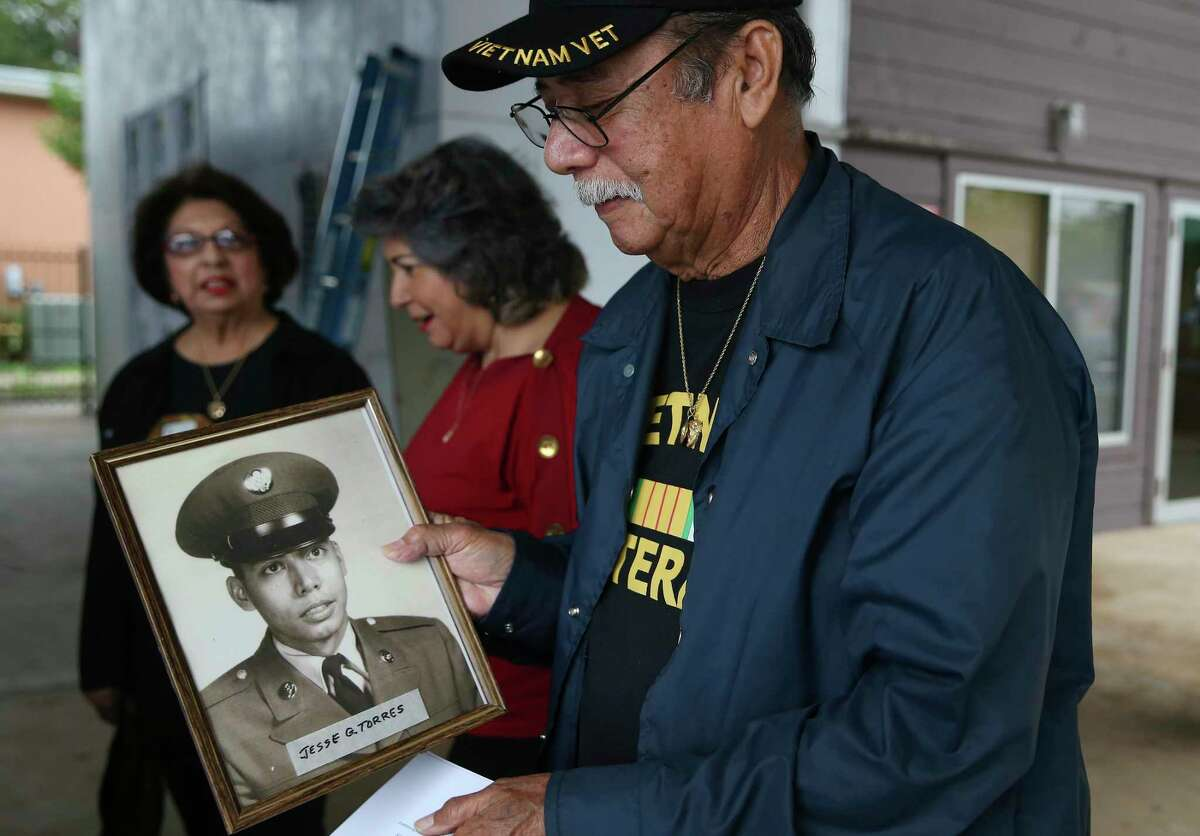 Vietnam veteran Jesse Torres, 75, arrives with his military portrait at a ceremony honoring military vets at the Good Samaritan Center on Thursday.